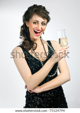 smiling brunette with a glass of wine