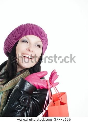 smiling brunette woman in fall clothes holding shopping bags - stock photo
