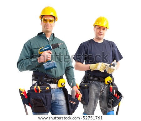 smiling builders. Isolated over white background - stock photo