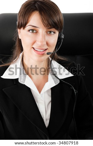 Smiling business customer service woman with headset - stock photo