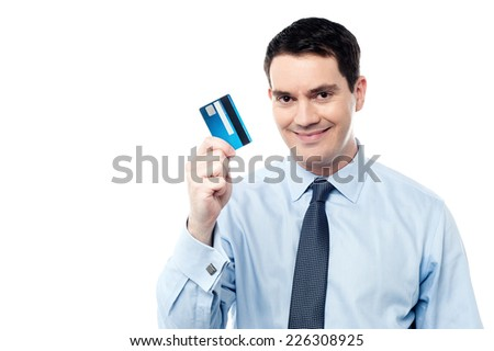 Smiling business executive showing his credit card - stock photo
