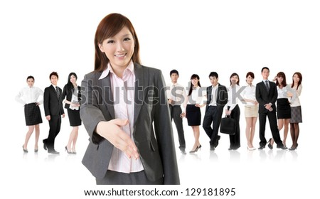 Smiling business executive woman of Asian make a handshake with you in front of her team isolated on white background. - stock photo