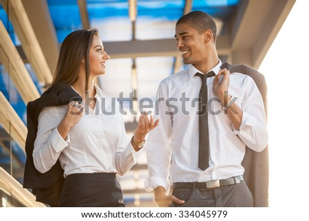 smiling business man and woman on break ,walking around and talking - stock photo