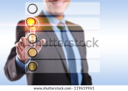 smiling business man choosing and pushing a button from a blank list of options