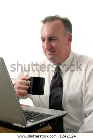 smiling business man drinking coffee and looking at laptop computer; isolated on white background