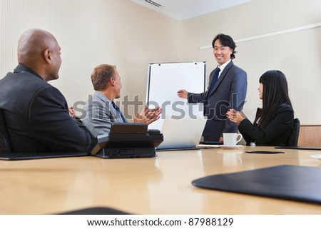 Smiling business man giving a presentation to associates - stock photo