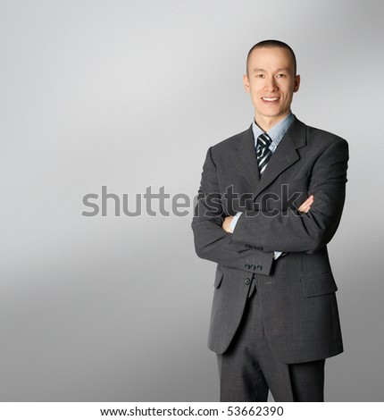 smiling business man in suit isolated on white - stock photo