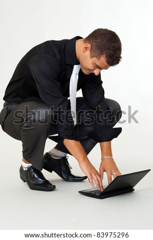 Smiling business man looking laptop - stock photo