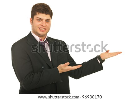 Smiling business man making presentation to right part of image isolate don white background