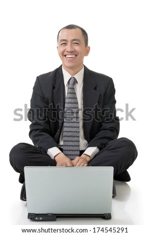 Smiling business man of Asian sit and use laptop on ground, full length on white background. - stock photo