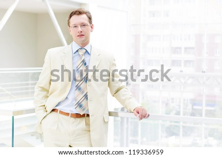 Smiling business man , on the balcony - stock photo