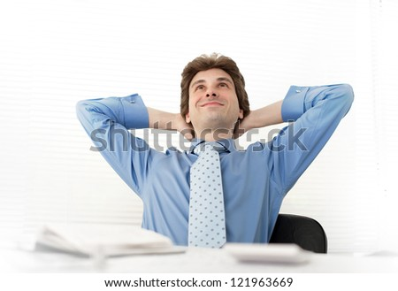 smiling business man relaxing in the office - stock photo