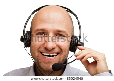 Smiling business man talking headphones or headset - stock photo
