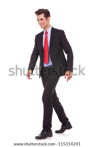 smiling business man walking on a white background, looking away from the camera - stock photo