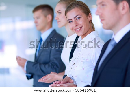 Smiling business people applauding a good presentation in the office . - stock photo