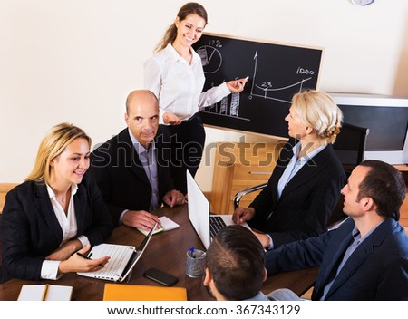 Smiling business people during communication call indoors