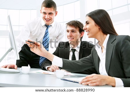 Smiling business people  in board room - stock photo