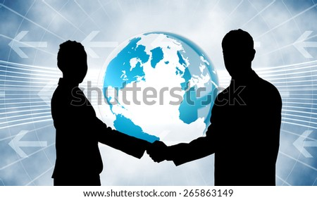 Smiling business people shaking hands while looking at the camera against global business graphic in blue - stock photo