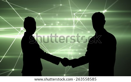 Smiling business people shaking hands while looking at the camera against glowing geometric design - stock photo