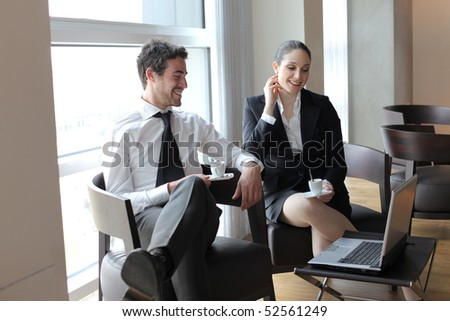 Smiling business people sitting in a lounge - stock photo