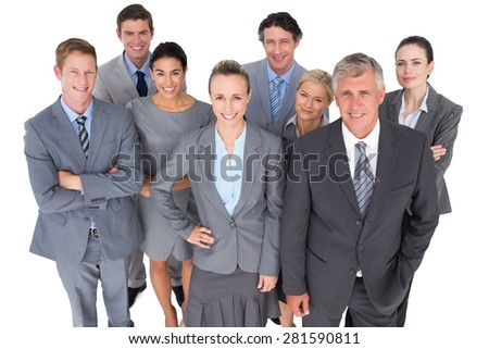 Smiling business people smiling at camera on white background