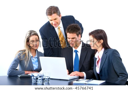 Smiling business people team working in the office with laptop - stock photo
