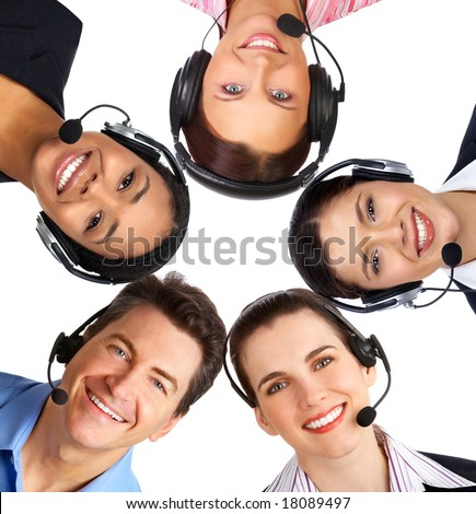 Smiling  business people  with headsets. Over white background - stock photo