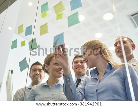 smiling business people with marker and stickers - stock photo