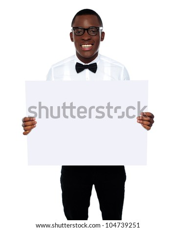 Smiling business representative in glasses holding blank whiteboard
