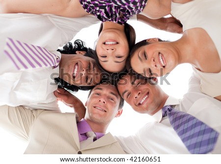 Smiling business team in a circle with heads together against white background