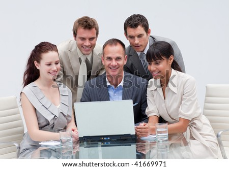 Smiling business team working together in an office