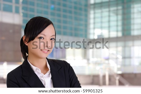 Smiling business woman, closeup portrait in office. - stock photo
