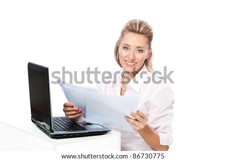 Smiling business woman doing paperwork - stock photo