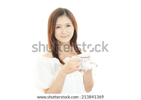 Smiling business woman drinking coffee. - stock photo