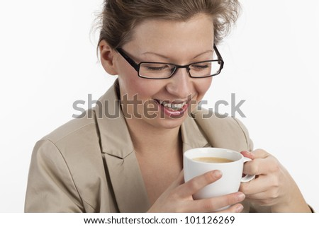 Smiling business woman enjoying a cup of coffee - stock photo