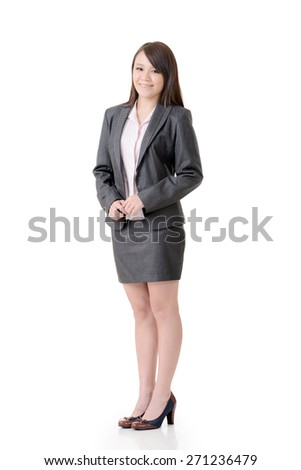 Smiling business woman, full length portrait on white background.
