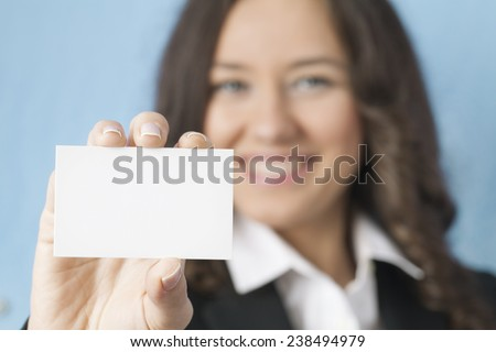 Smiling business woman giving blank business card