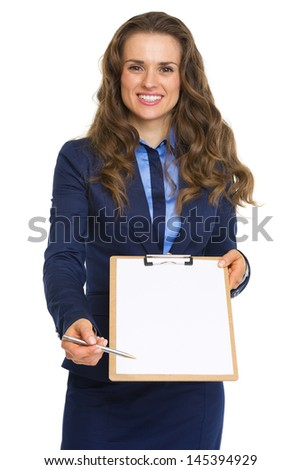 Smiling business woman giving clipboard for sign