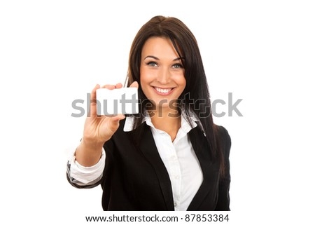 Smiling business woman handing a blank business card over white background - stock photo