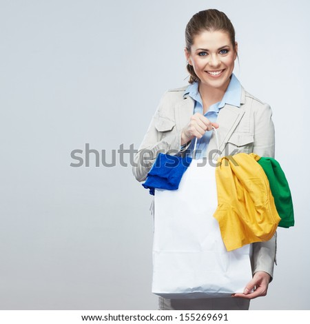 Smiling Business woman hold white shopping bag. Female studio portrait - stock photo