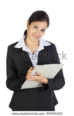 Smiling business woman holding a clipboard - stock photo