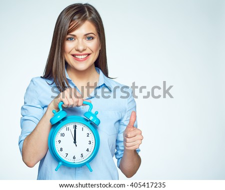 Smiling Business woman holding alarm watch. Isolated portrait. - stock photo