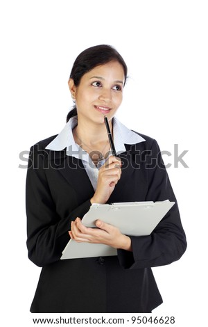 Smiling business woman holding clipboard
