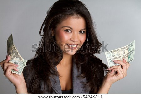 Smiling business woman holding money - stock photo
