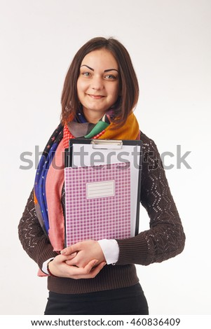 Smiling business woman holding notebooks