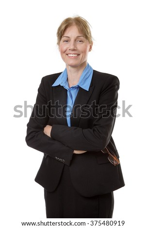 Smiling business woman in a blue shirt with arms folded. Isolated on white background.
