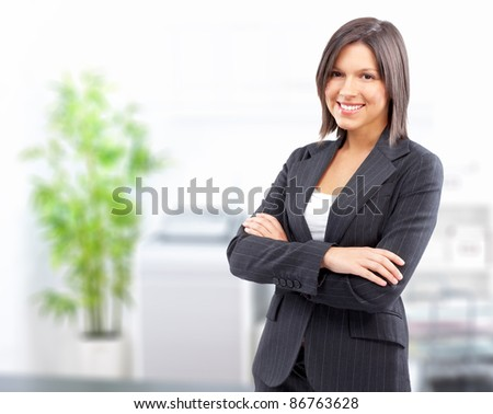 Smiling business woman in a modern office.