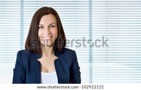 Smiling business woman. Isolated over jalousie - stock photo