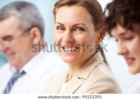 Smiling business woman looking directly at camera - stock photo