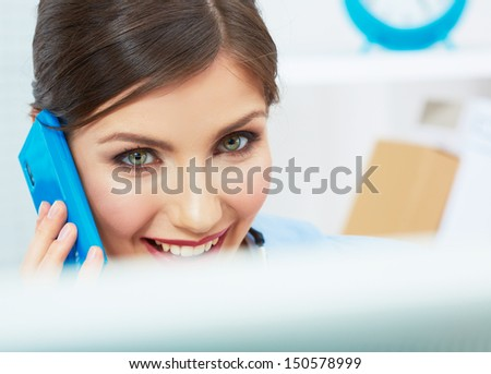 Smiling business woman on phone at office. Close up female portrait in white office. Posing young model. - stock photo